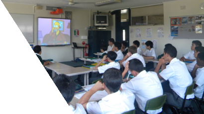 Students watching a captioned video of The Simpsons in a classroom