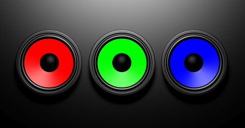 Three colourful speakers on a dark background