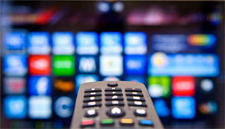 Remote control pointed at a Smart TV