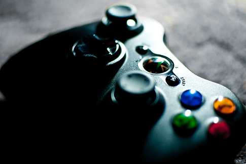 Xbox 360 controller resting on a flat surface. Image credit: Steve Petrucelli, Flickr