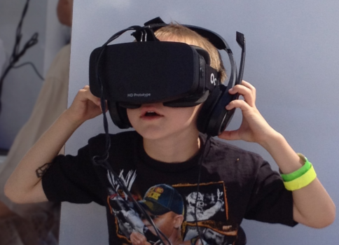 Young boy using an Oculus Rift HD Prototype headset and headphones. Image credit: Skydeas, Wikipedia Commons