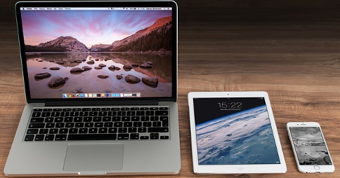 Apple products on display. From left to right: MacBook, iPad Air and iPhone 6 Plus
