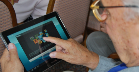 Elderly person using a Samsung tablet device. Image credit: Wikipedia commons