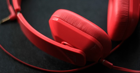 Circumaural headphones resting on a flat surface