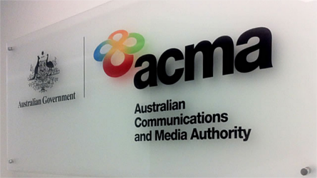 Australian Government | ACMA: Australian Communications and Media Authority logos printed on a glass panel. Image credit: acma.gov.au