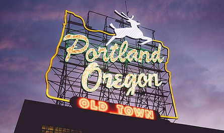 "Neon sign reading ""Portland, Oregon, Old Town"" lit up at dusk"