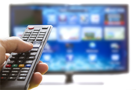 Left hand pointing remote control at TV screen
