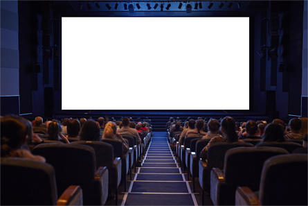 Crowded cinema with people seated in front of a blank screen