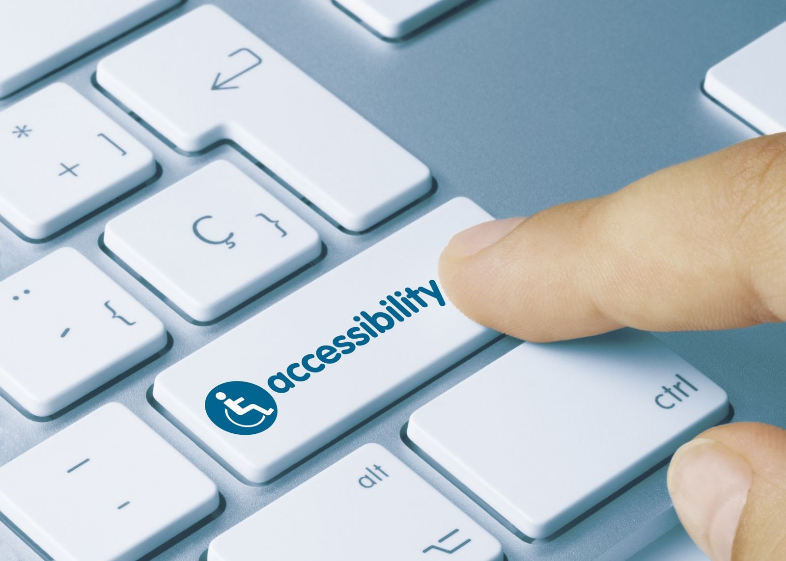 Image of an accessibility button on a laptop keyboard