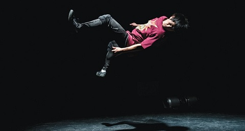 Image of male dancer performing parkour move