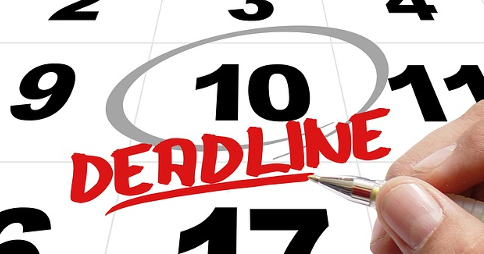 Number 10 circled on calendar with the word 'Deadline' written below; right hand holding pen underneath