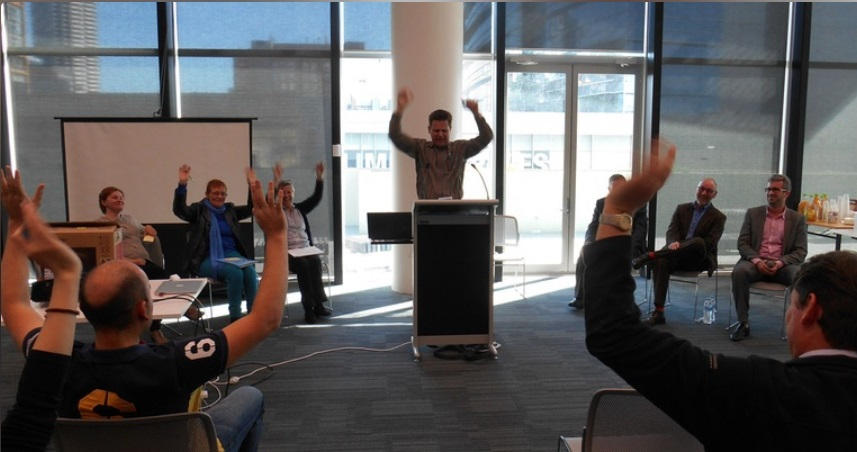 People raising their hands at the 2016 Perth Access Camp